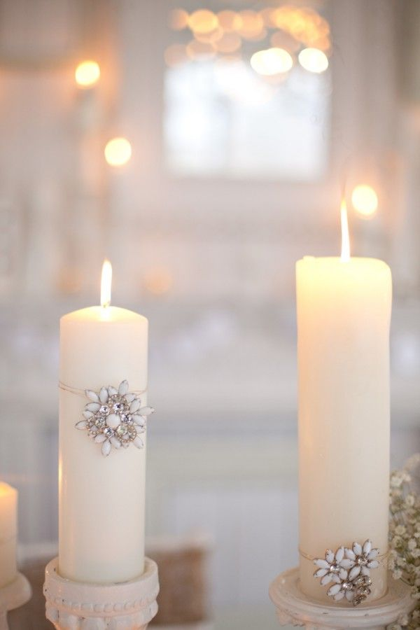 White pillar candle centerpieces and weddings