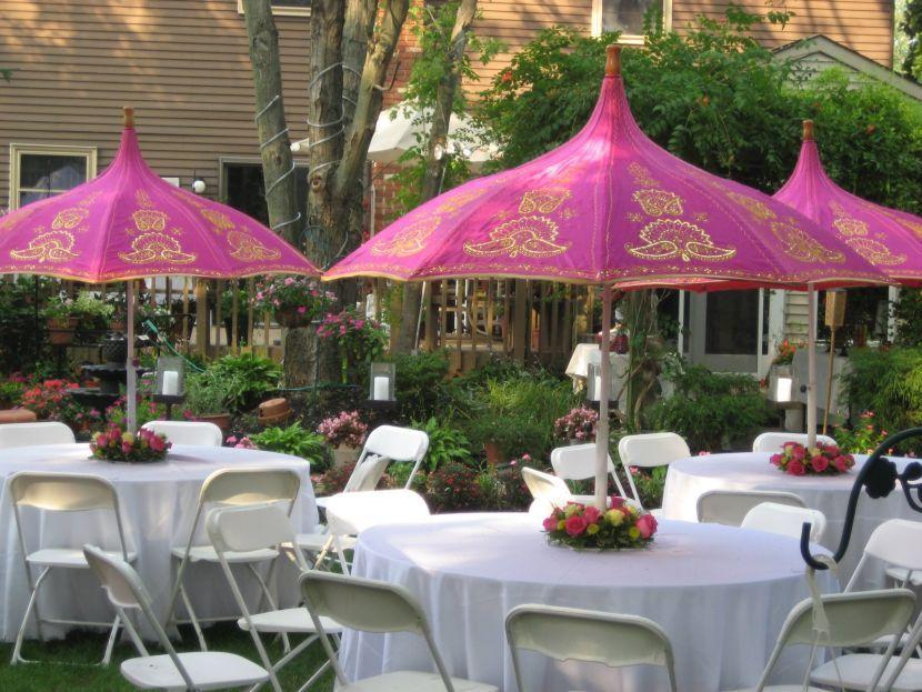 White wedding garden party table decor with flower bouquets and white wedding garden party table decor with flower bouquets and pink umbrellas as centerpieces junglespirit Images
