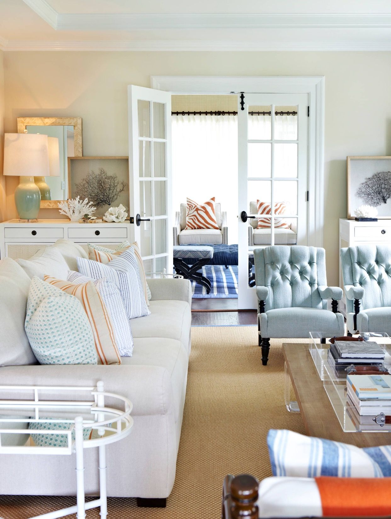 Open Concept Coastal Living and Dining Room with sea fan art