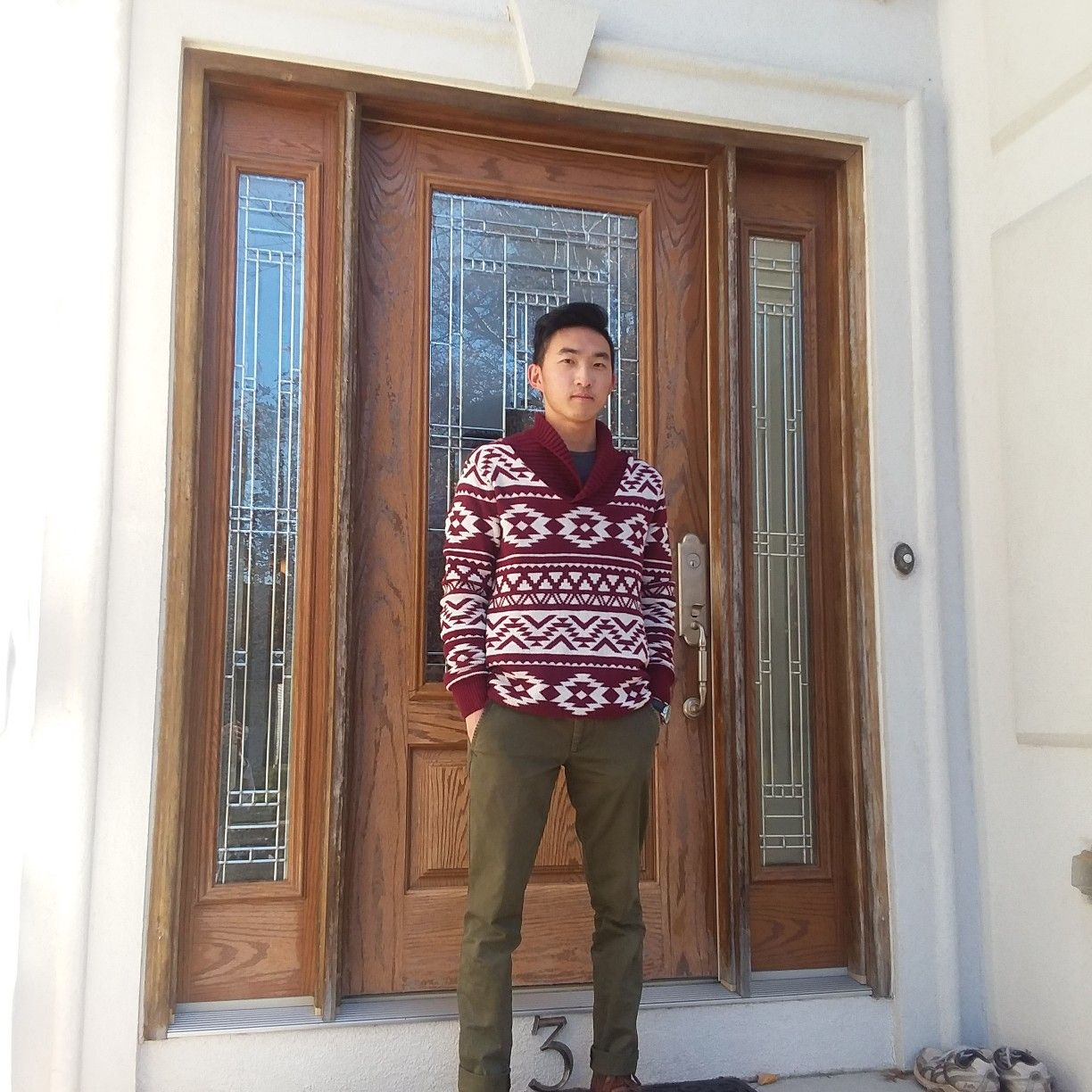 Red and white Christmas sweater green chinos outfit ideas in