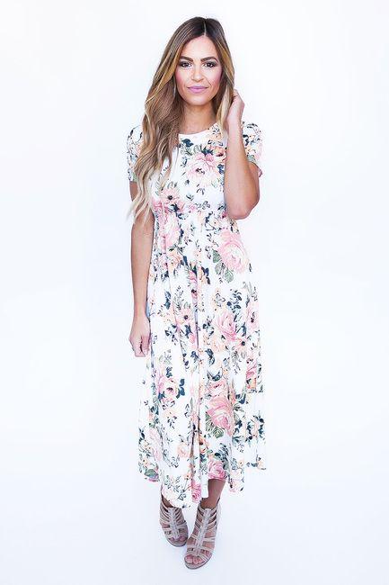 b1c189a91b8 Ivory/Peach Floral Midi Dress. Ivory/Peach Floral Midi Dress. Dottie  Couture BoutiqueFloral ...