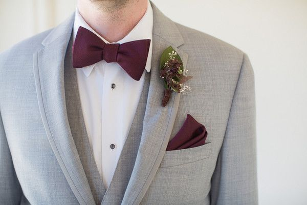 adfdbb20e870c Groom in light gray tuxedo with burgundy bow tie and matching pocket square  {Joleen Willis Photography}