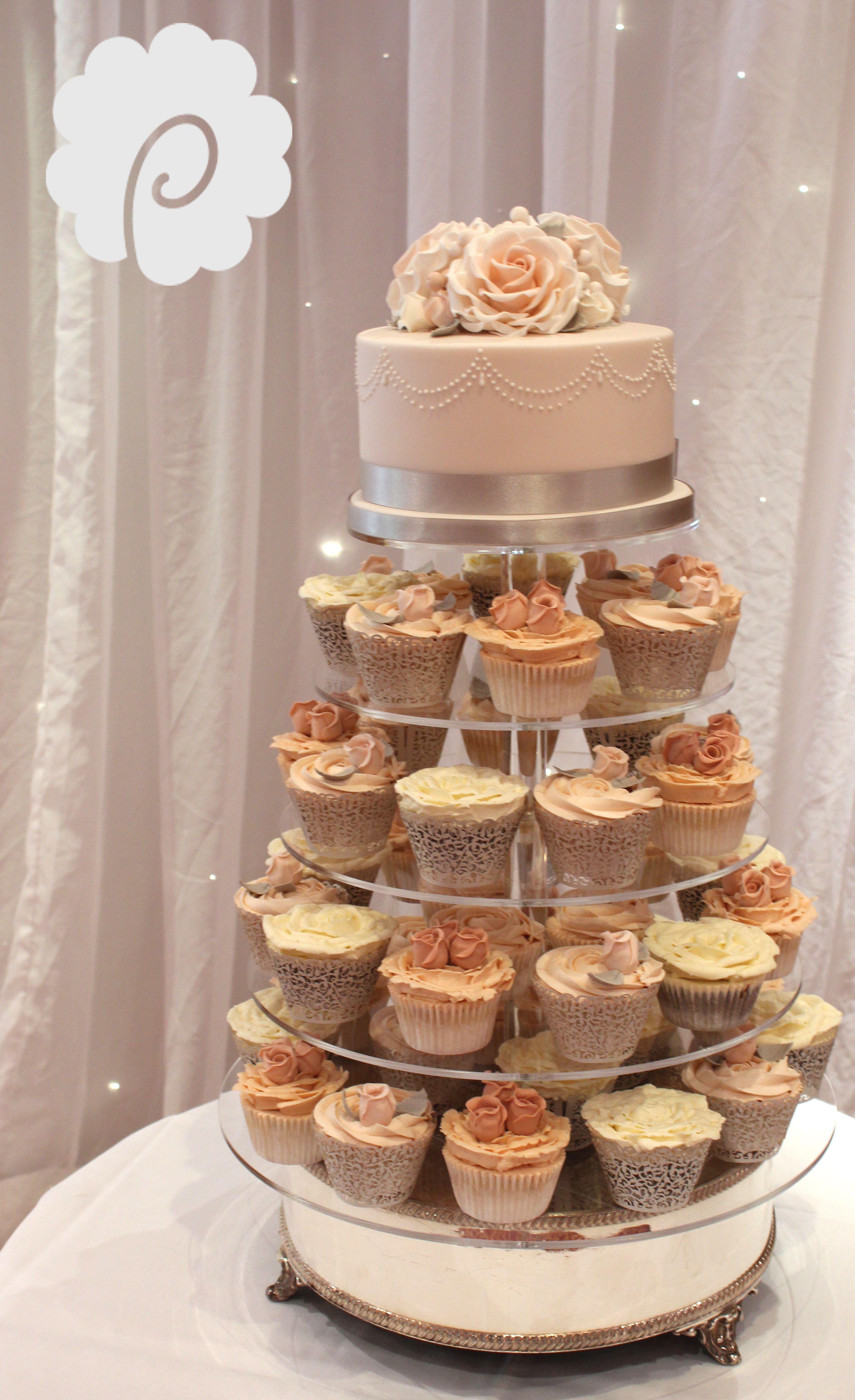 A soft peach blush & grey wedding cupcake and cake tower