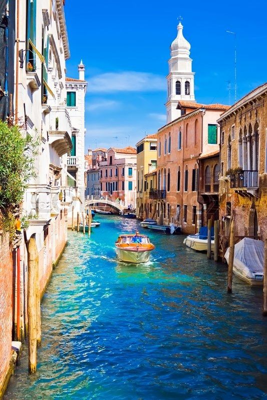 Stock image of 'A motor boat in beautiful canal, Venice, Italy'