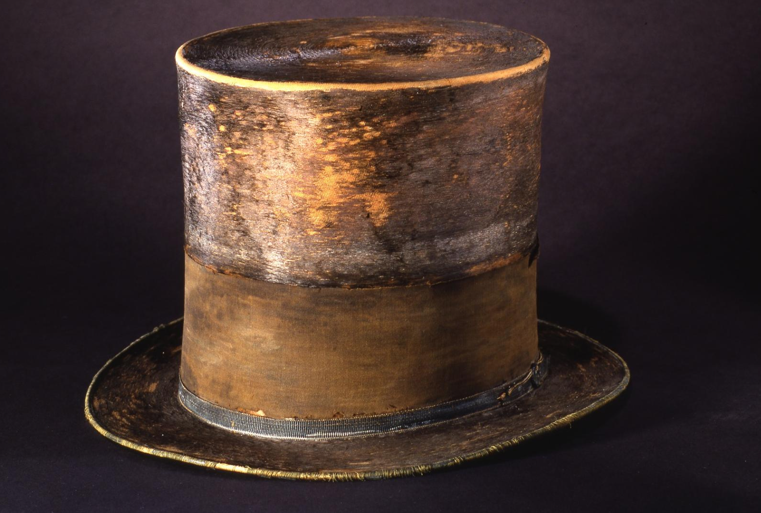 The top hat Abraham Lincoln was wearing in Ford's Theatre, the night he was assassinated on April 14, 1865. The hat has a black silk mourning band which was added in remembrance of Lincoln's son Willie. This hat was transferred from the War Department to the Patent Office, with permission from Mary Lincoln, in 1867. #Lincoln #USA #Hat