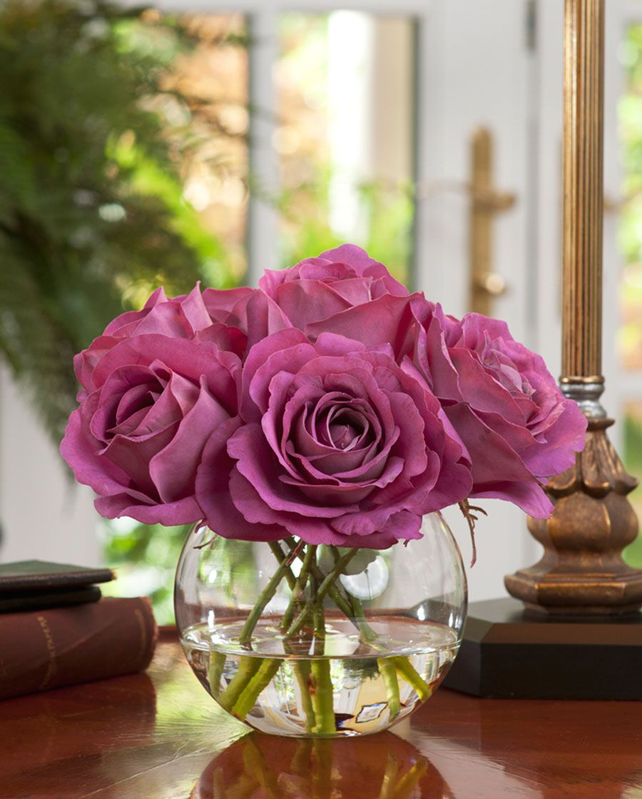 cool water roses in bubble vases Centerpiece