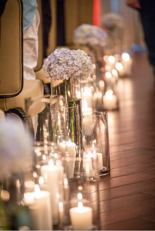 candlelit wedding ceremony - candles in votives lining ...