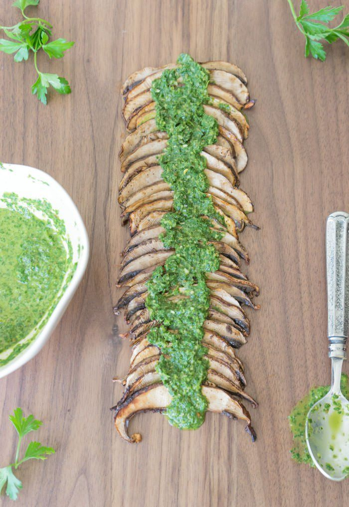 A delicious appetizer of thinly-sliced marinated mushrooms with an Argentinian chimichurri sauce.