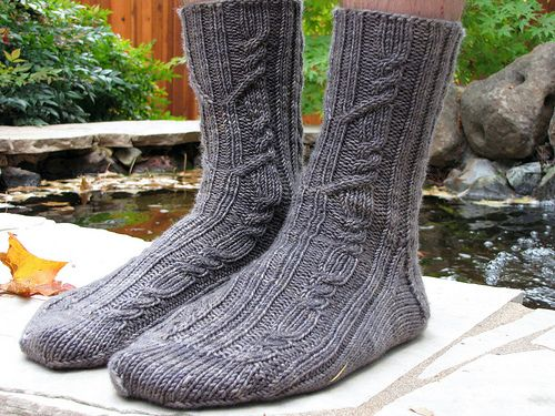 Instructions are written for a cuff-down sock. Sizes are provided for either a men's sock with sport weight yarn or a women's sock with fingering weight yarn. Written instructions include charts specific to each size and are provided on the last pages.