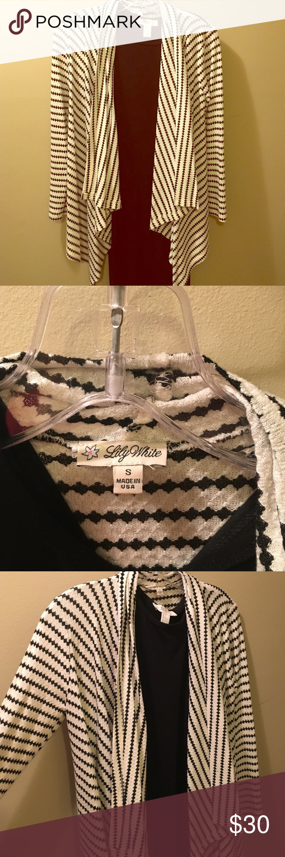 Open and flows sweater Lily White black and cream diamond strip design open and float sweater! This sweater is super fun and coZy! It's pretty lightweight and perfect for the temperature changes! Worn once! Lily White Sweaters Cardigans