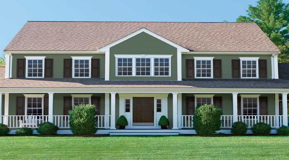 Houses with green vinyl and white trim vinyl siding for Green siding house