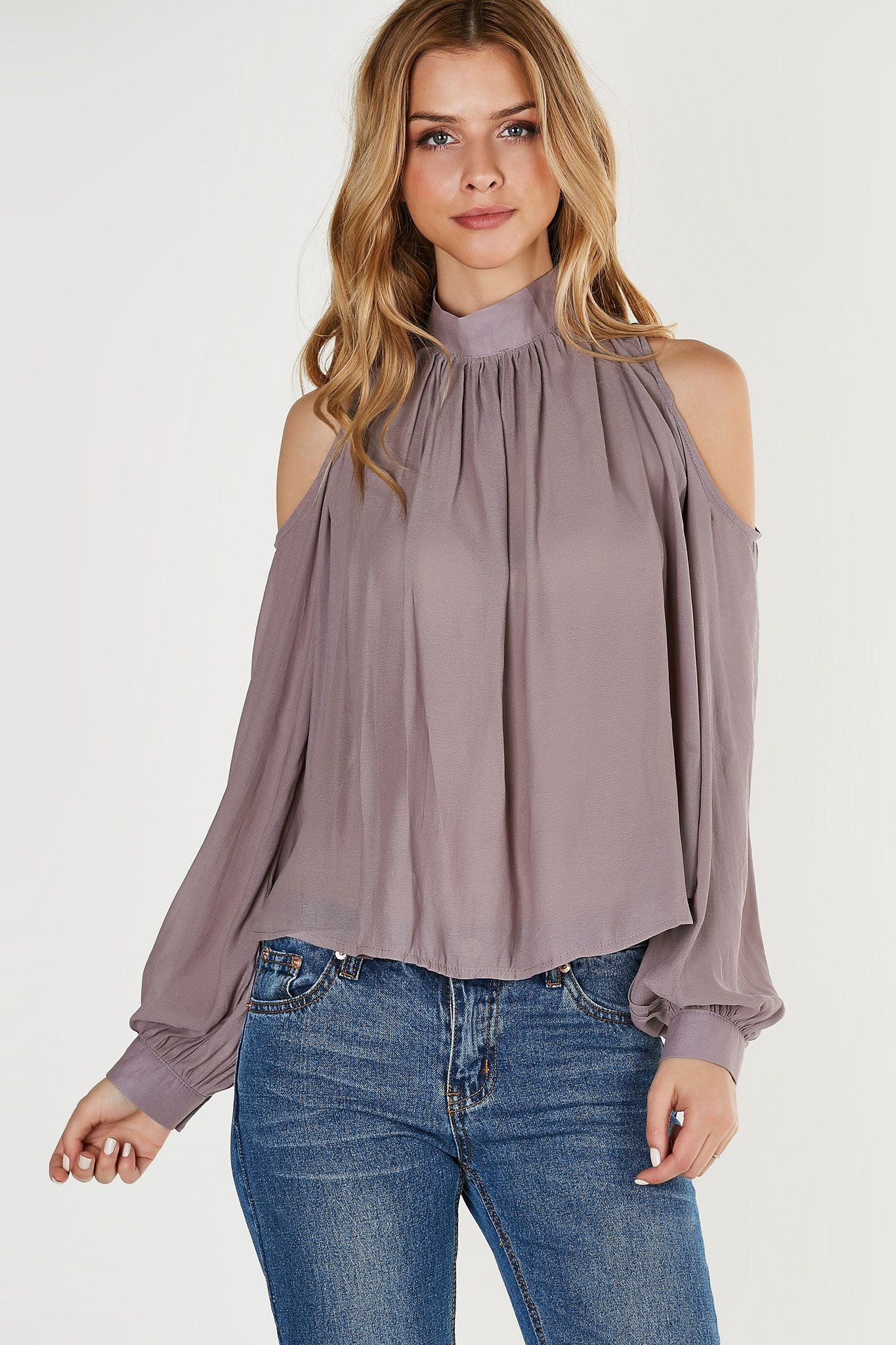 28c161c43f5b34 Chic mock neck blouse made of lightweight chiffon material. Long sleeves  with cut outs on shoulders and back.