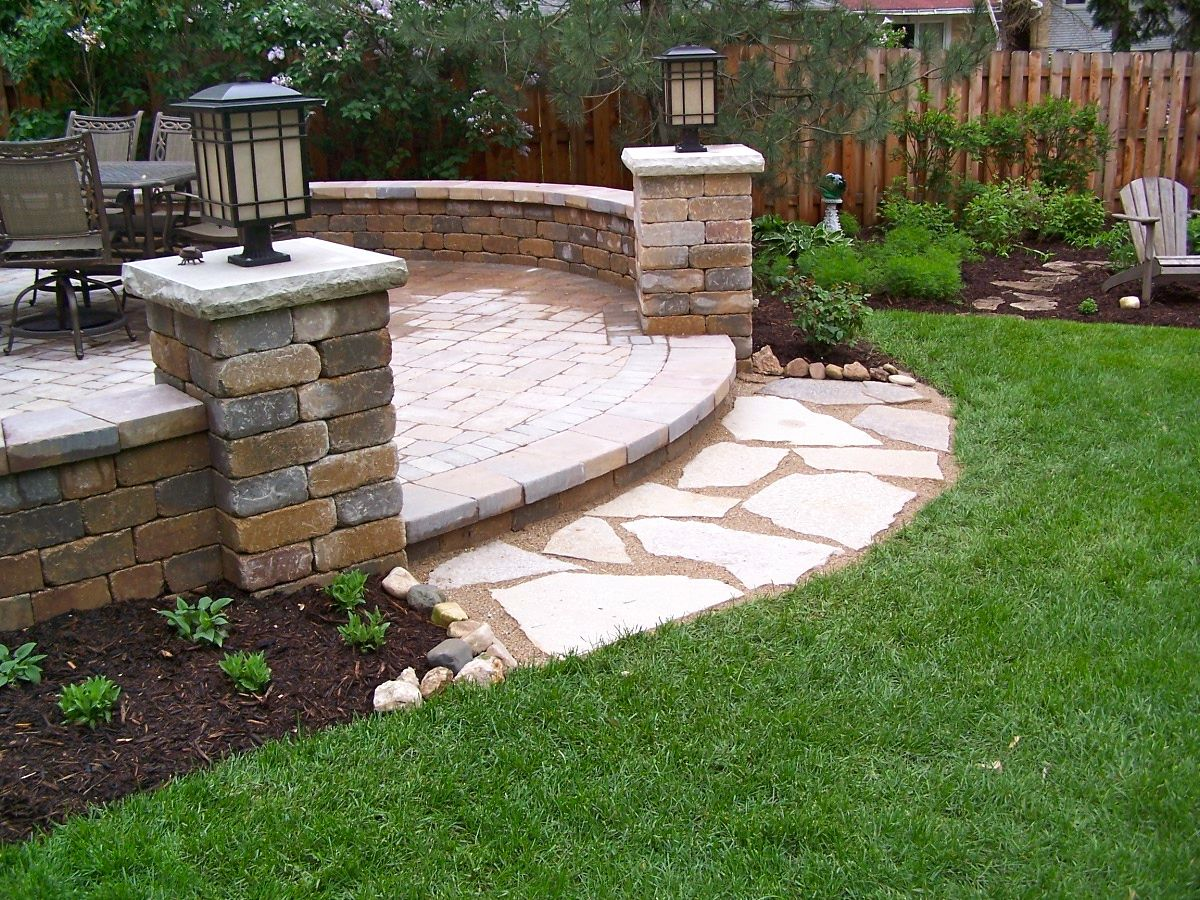 Patio Stone Walls : Backyard unilock patio seat walls pillars flagstone