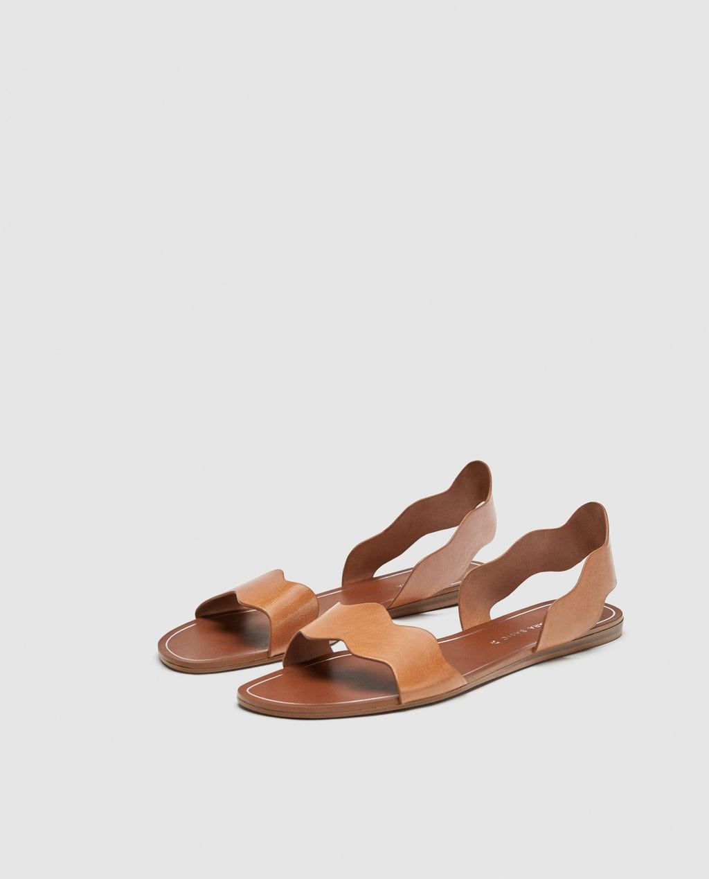 9978ca00a04 Image 4 of LEATHER SLIDES WITH WAVY STRAPS from Zara