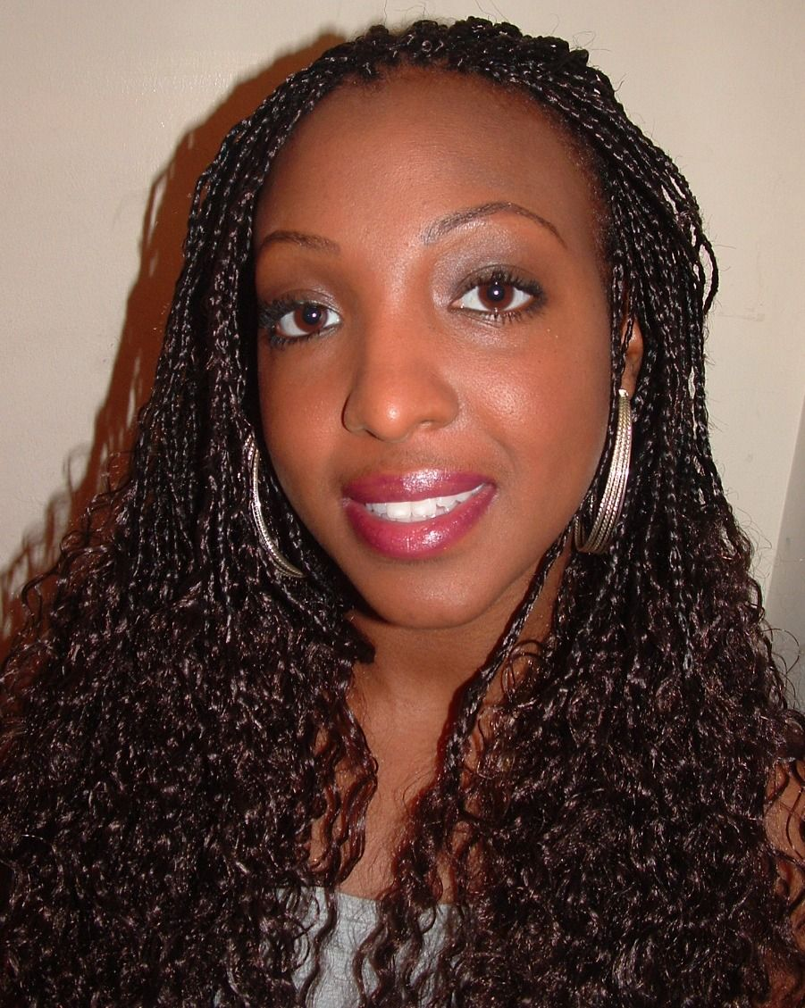 curly hand braided hair | wavy single plaits with extensions at