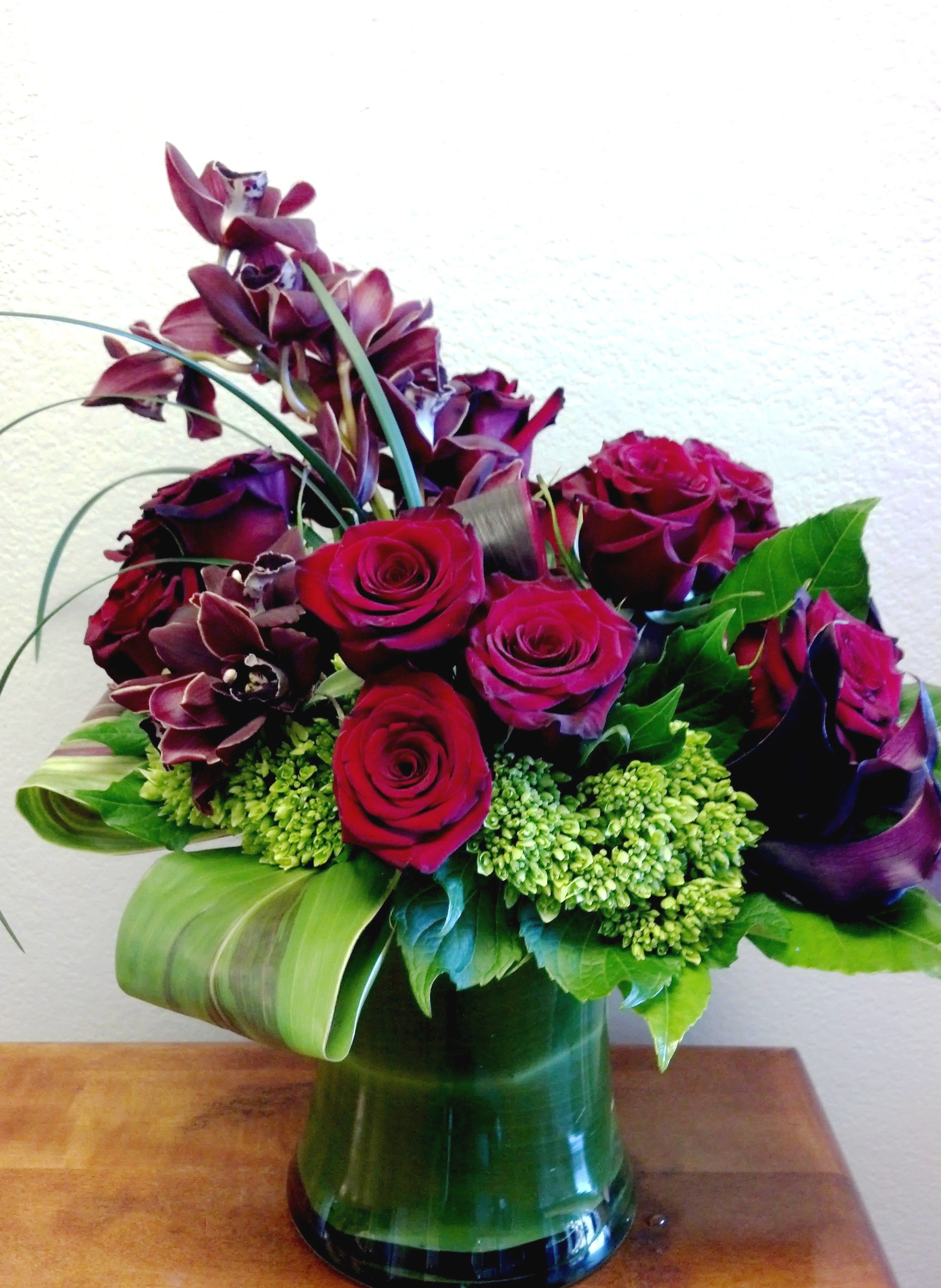 A contemporary, romantic flower bouquet. #redroses #orchids ...