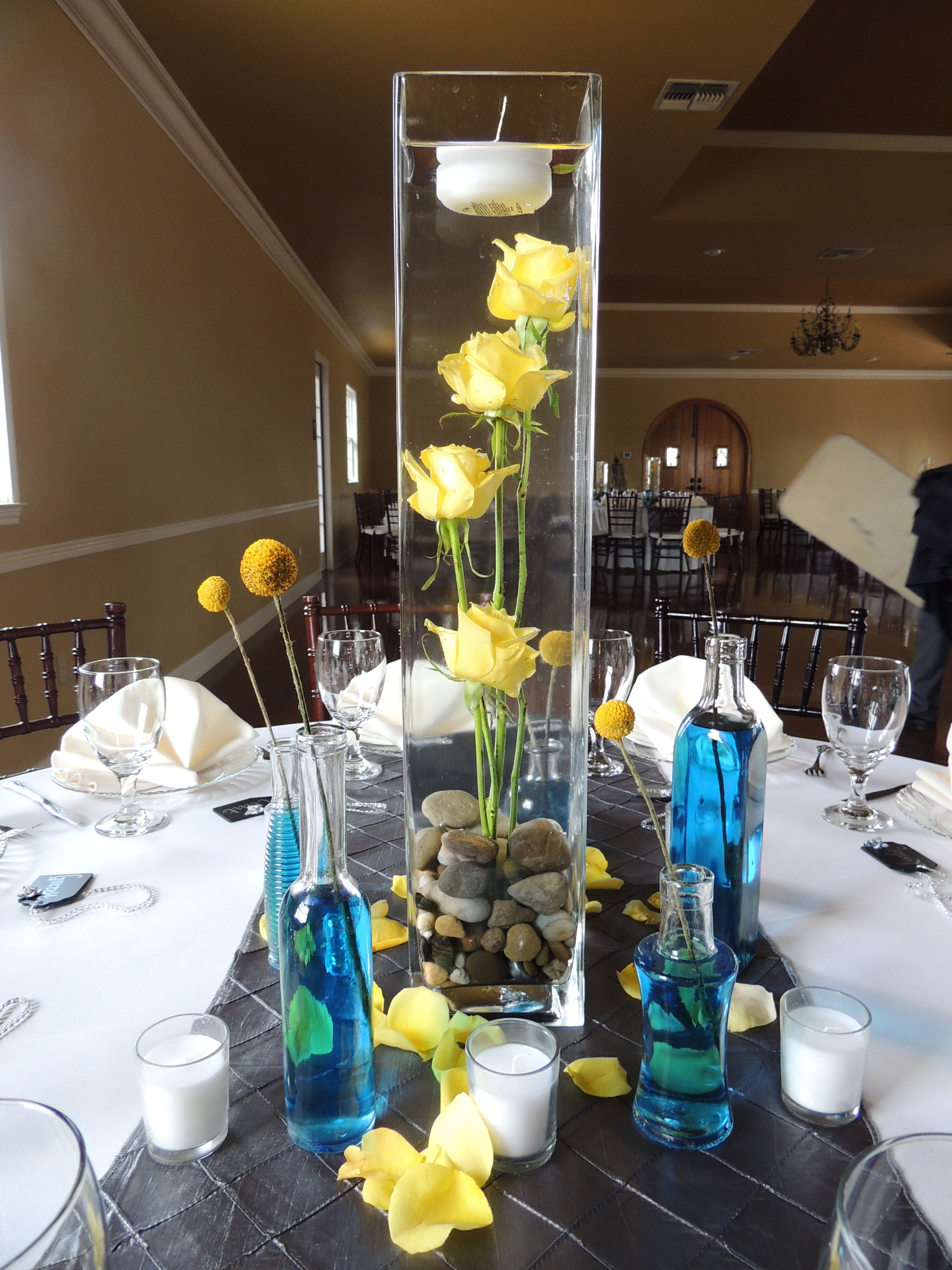 Tall Center Piece Wedding Reception Under Water Flowers