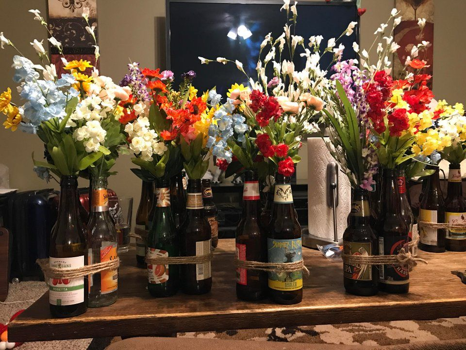 Fake Flowers And Beer Bottles Look Pretty Amazing Weddingplanning Fake Flowers Wedding Table How To Look Pretty