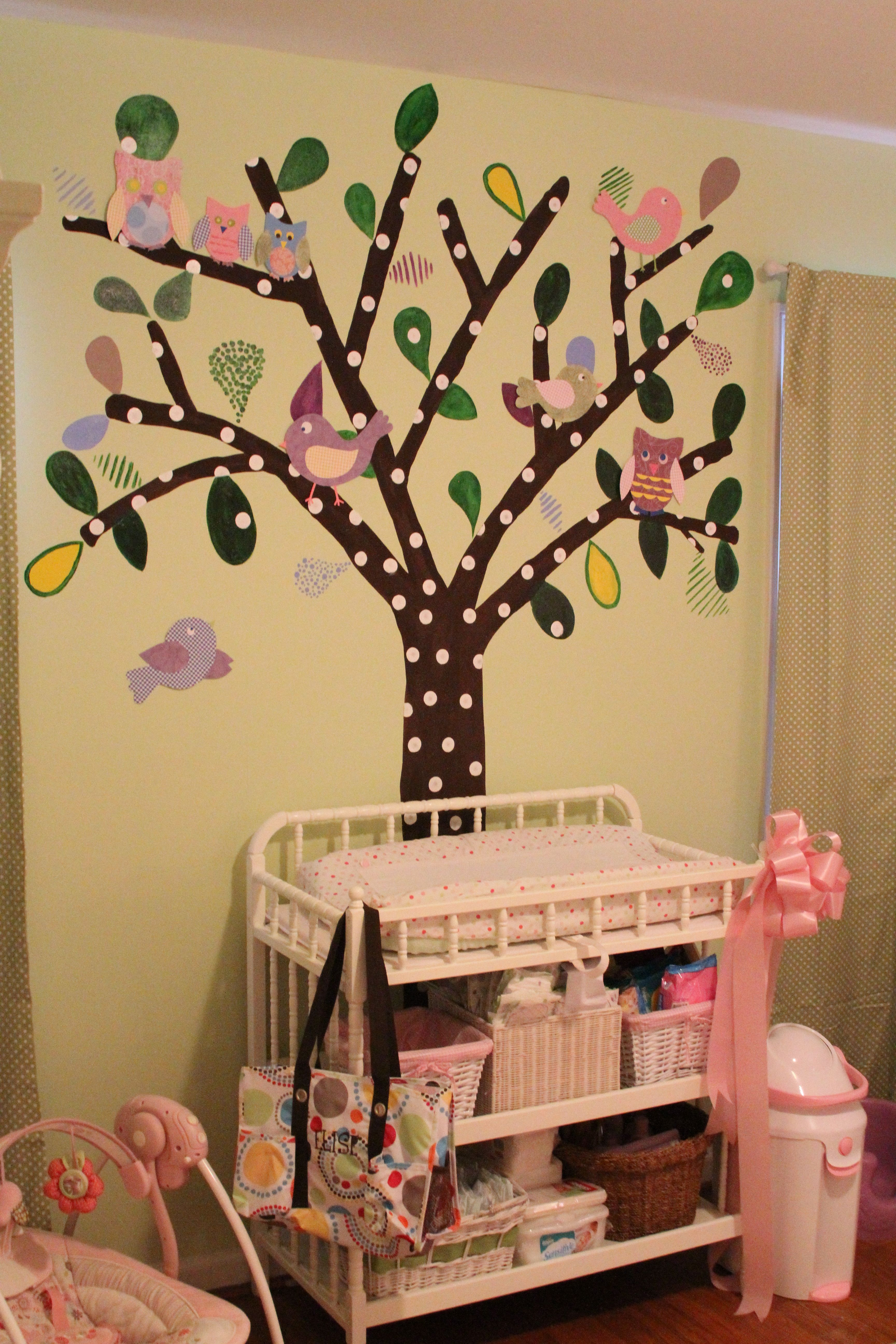 Sharing this one.  My wife and i painted the tree on the wall and then made the owls and birds with scrapbooking paper during the tornadoes last April.  We based it off of our pottery barn crib bedding.