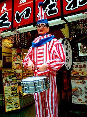 Kuidaore Taro is a famous drummer boy thingy in the Dotonbori area of Osaka Japan