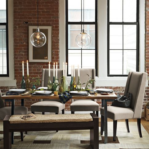 West Elm Industrial Dining Table ~ is this set in a loft? Love the exposed brick as a backdrop.