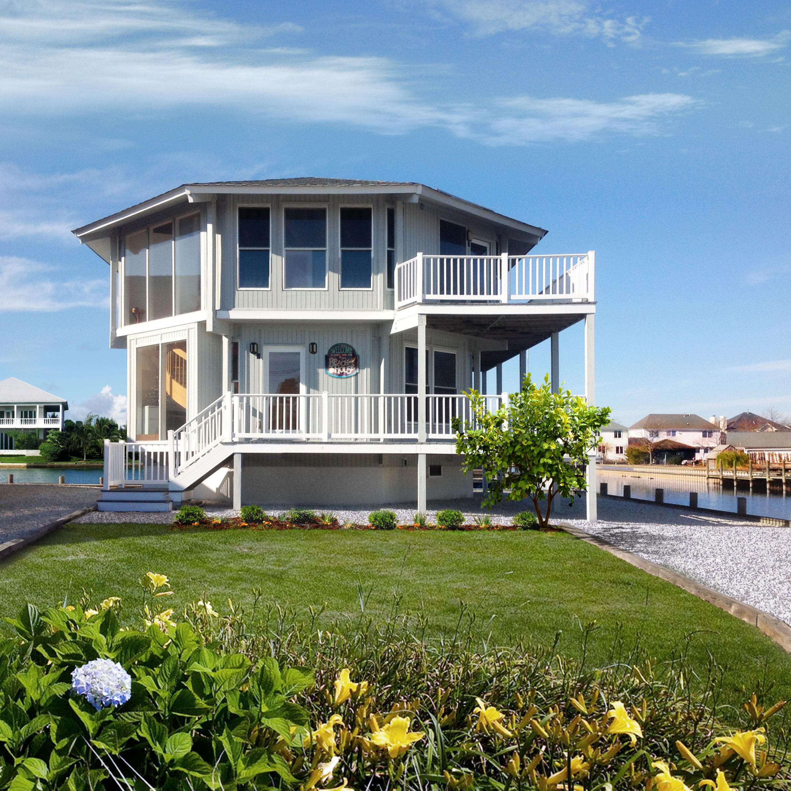 This Slightly Elevated Two Story Home Built On The Intracoastal Waterway Features 360 Degree Views On Both Le Coastal House Plans House On Stilts House Plans