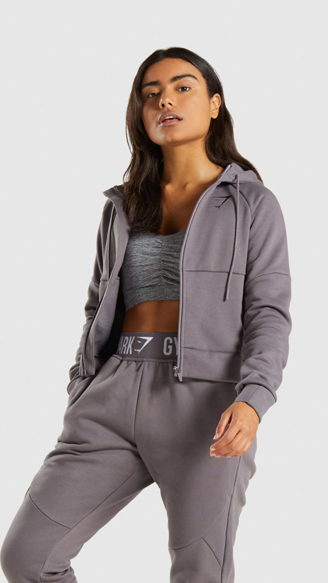 193ab38b9d029 Push and pull to your limit. The Comfy Tracksuit Zip Top gives you full  freedom to conquer your workout. Throw it over on your commute or keep warm  and ...