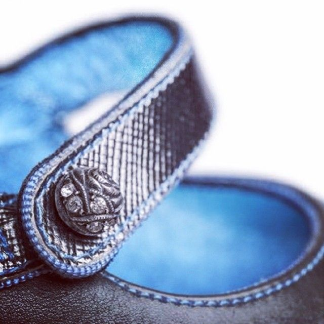Detail showing grosgrain edge,blue lining and thread and antique button of another metallic leather shoe from Caroline Groves. #attentiontodetail