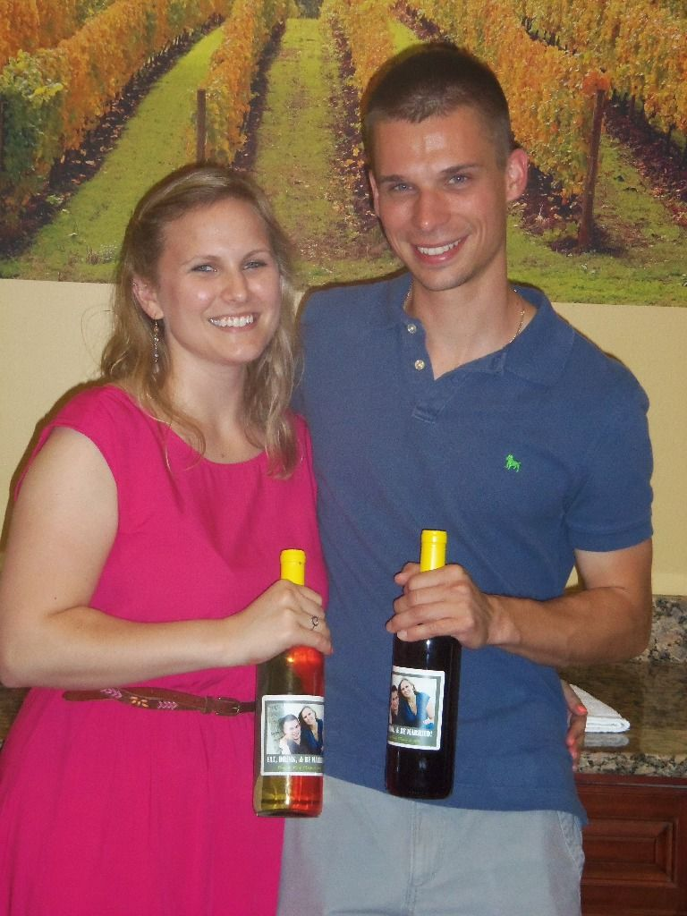 Very Happy Bride and Groom with their finished Wedding Favors.  They made 240 bottles - 120 Merlot, 120 Pinot Grigio.