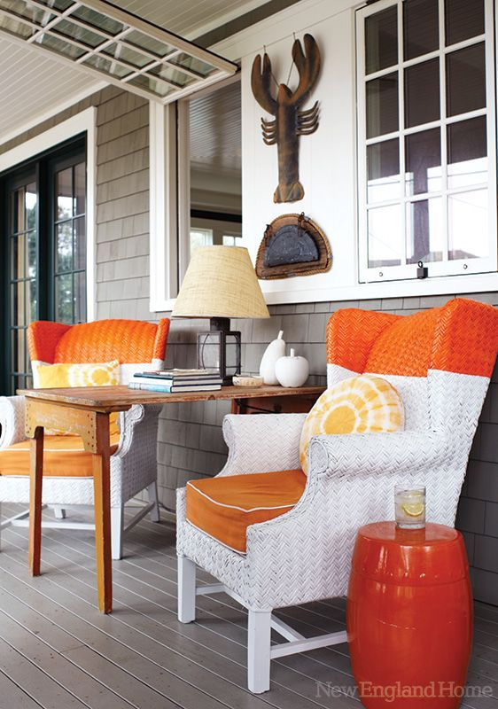 A designer's charming and beautiful beach house! From New England Home. Orange accents!