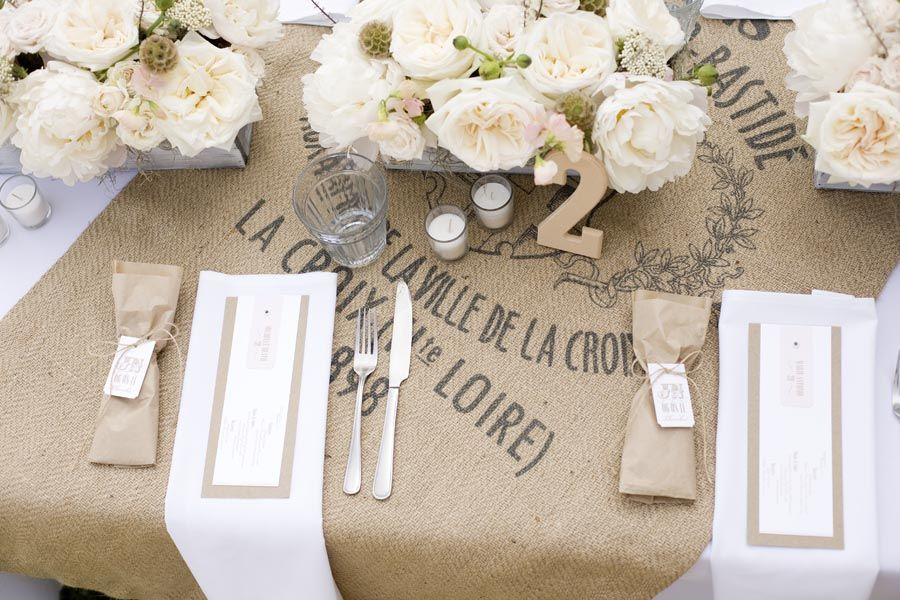 I like how this burlap has something printed on it.  I wonder if we could do that ourselves?