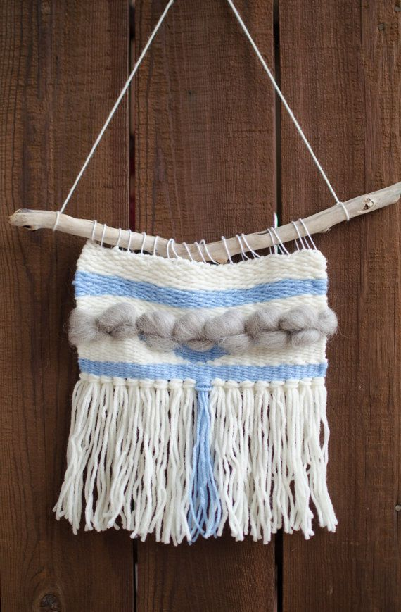 This wall hanging is ready to brighten up a spot that needs some cheer in your home. Made with wool and acrylic yarns and roving, and comes ready to