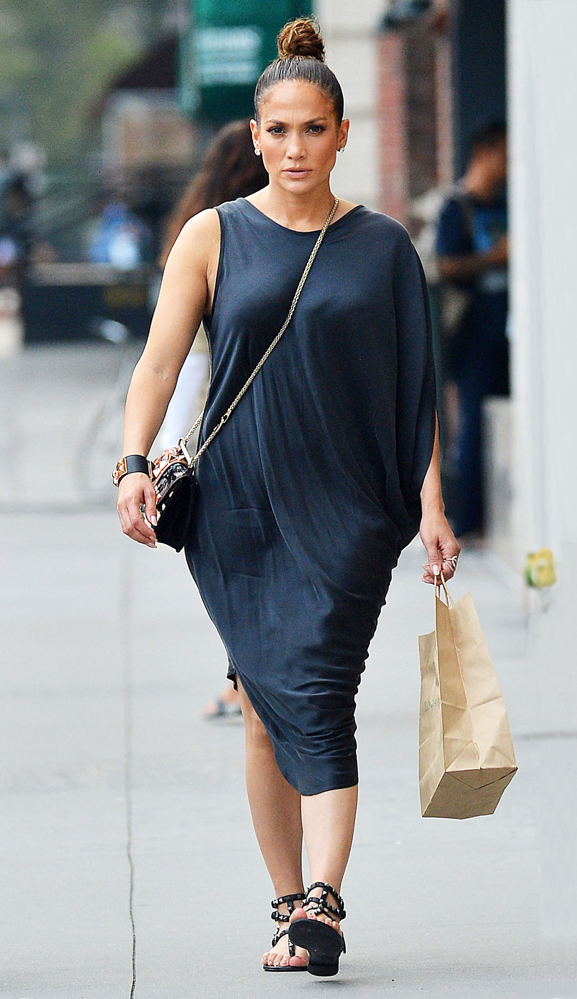 3aa719adbbd8 Jennifer Lopez Wears Breezy Black Dress and Studded Flat Sandals for N.Y.C.  Lunch Date from InStyle.com