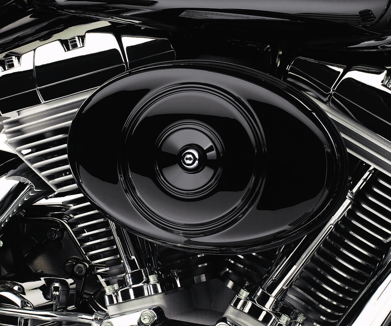 Available in vivid black or primed finish, this cover is ...