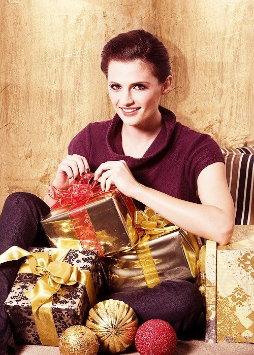 Stana unwrapping Christmas presents.  I havent seen this pic ever before but it seems to be older.