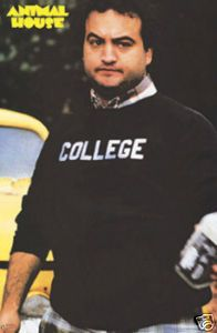 Animal House S John Belushi Wearing Iconic College Sweatshirt Comedy Films Good Comedy Movies Great Comedies
