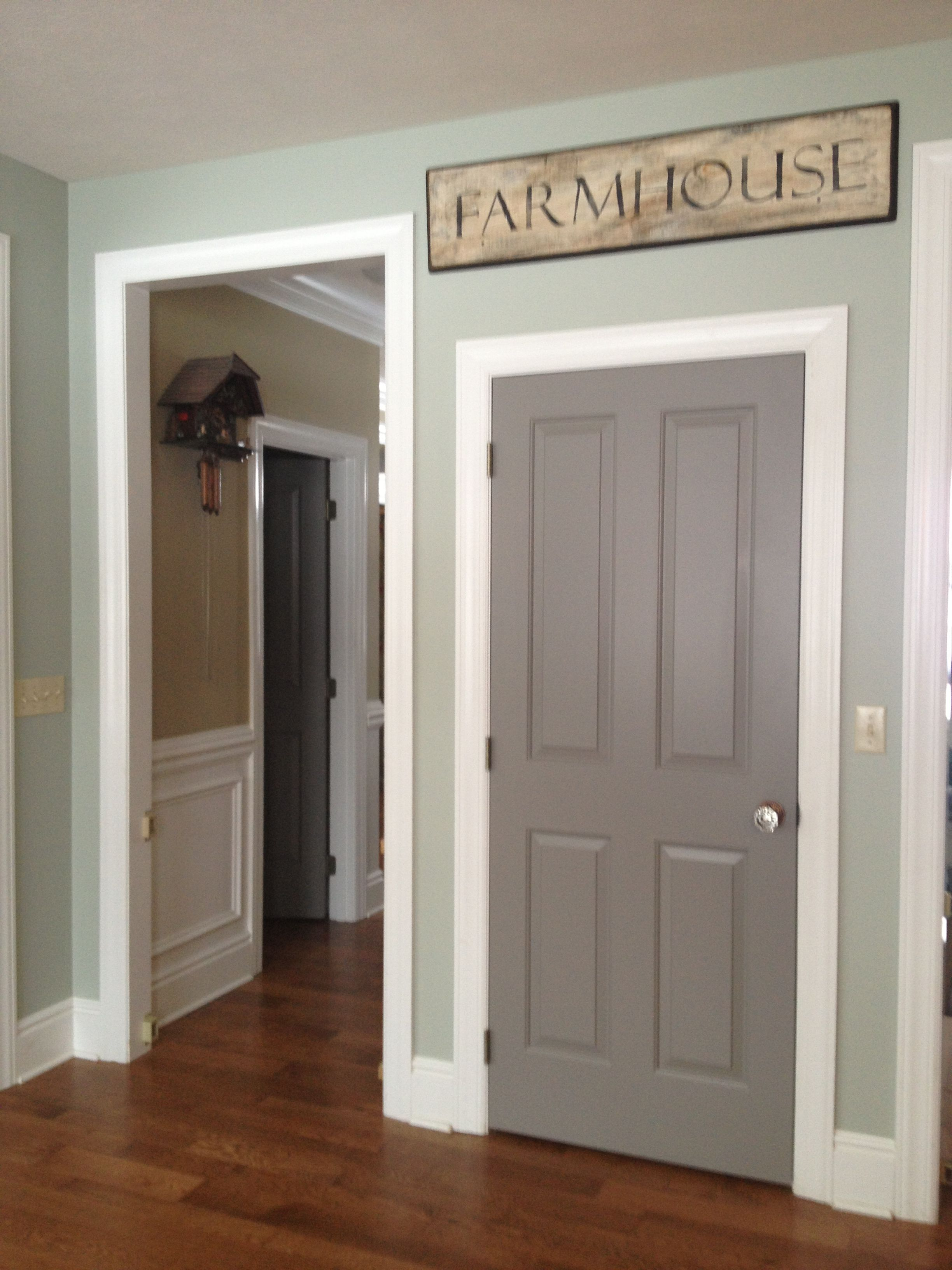 Sherwin Williams dovetail grey...the door color is what I ...