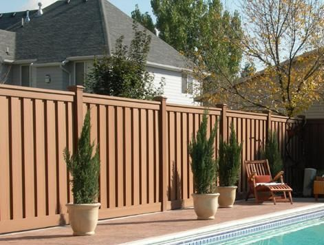 Cheap fencing ideas cheap composite fence boards for Cheap patio privacy ideas