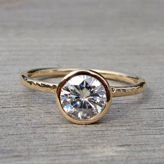 Forever One GHI Moissanite Engagement Ring, Recycled 14k Yellow Gold Solitaire, Simple, Hammered, Ethical Jewelry, Made To Order is part of Ethical jewelry, One carat diamond, Moissanite engagement ring, Forever brilliant moissanite, Jewelry, Engagement rings - taxes upon request   A LITTLE ABOUT ME AND MY SHOP  I am an ecofreak! Wherever I possibly can, I make decisions that support the health of the environment, as well as the people and other animals that inhabit our earth  I use recycled office supplies and shipping materials whenever possible  My studio electricity is generated from solar panels on our garage roof  I purchase carbon offsets for shipping  And of course my designs incorporate only recycled metals and ethically sourced stones  Please visit my 'About' page here on Etsy for more info! All of my jewelry is veganfriendly meaning no animal products (pearls, silk, leather, etc ) were used in its construction