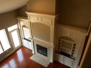 Sekas Homes - Custom home builder in Northern Virginia. Beautiful fireplace and built-in shelves.