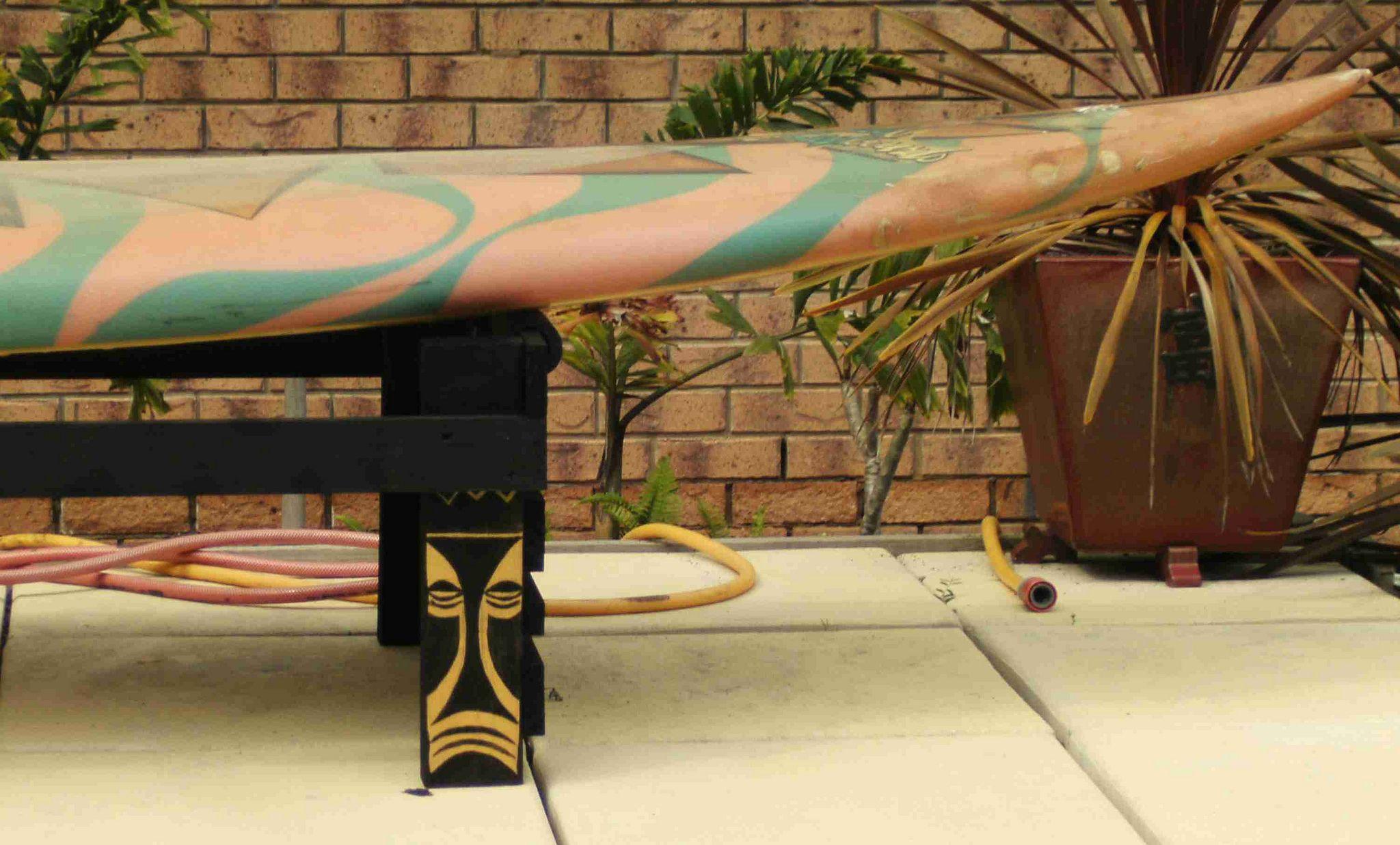 https://flic.kr/p/brPTw3   Closeup of tiki detail on poolside surfboard bench   Digital camera