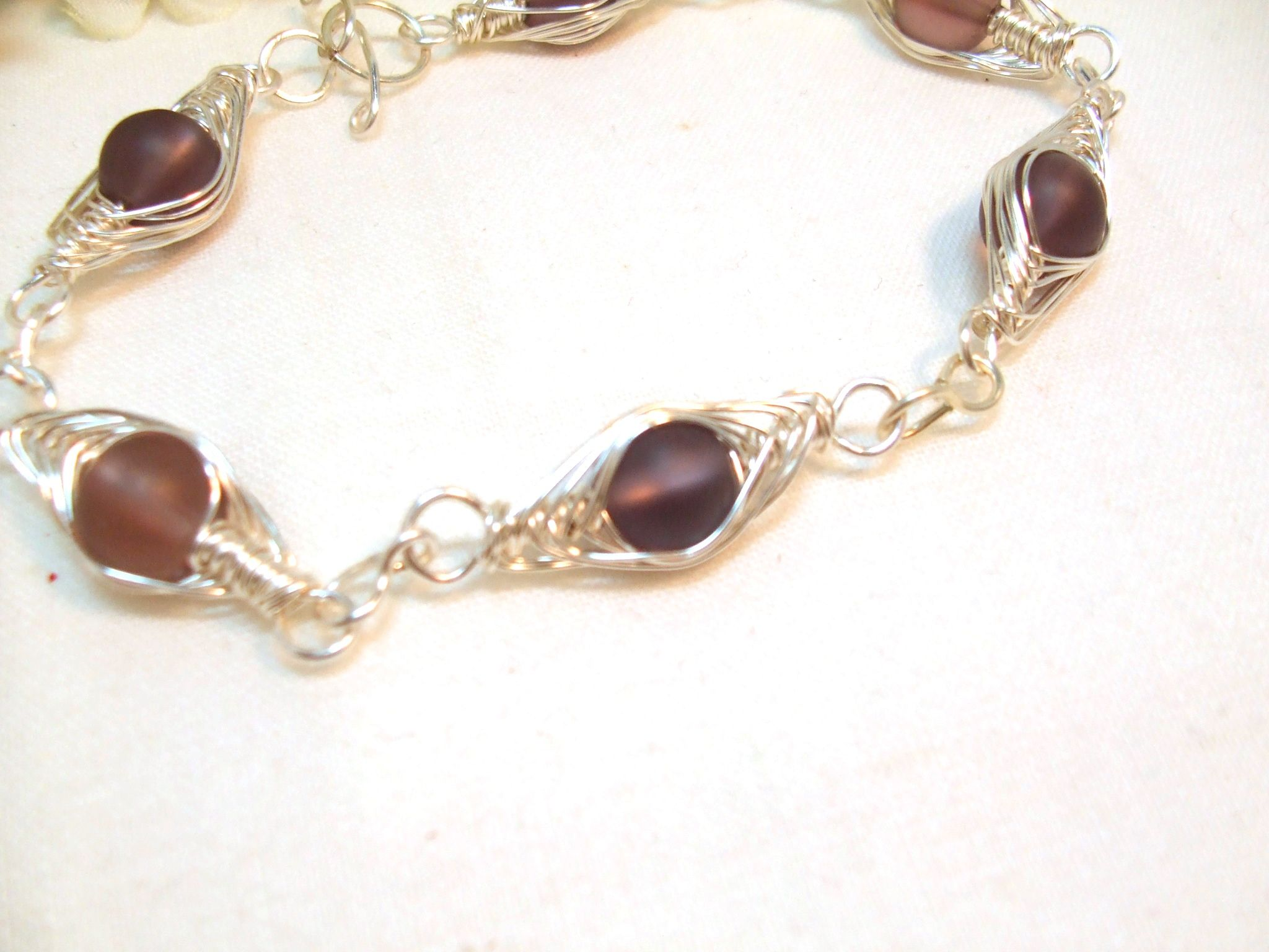 Grape beach glass beads and non tarnish wire wrapped in a ...