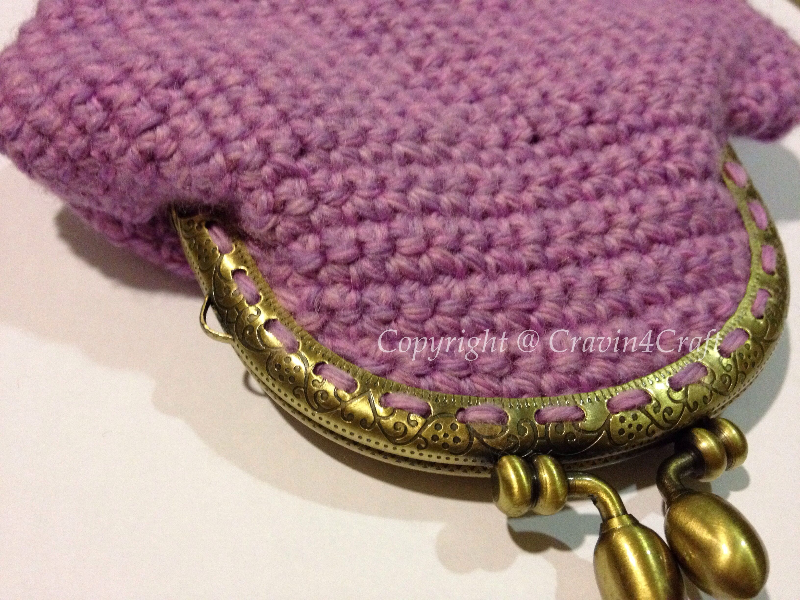 My very first crochet coin purse in purple