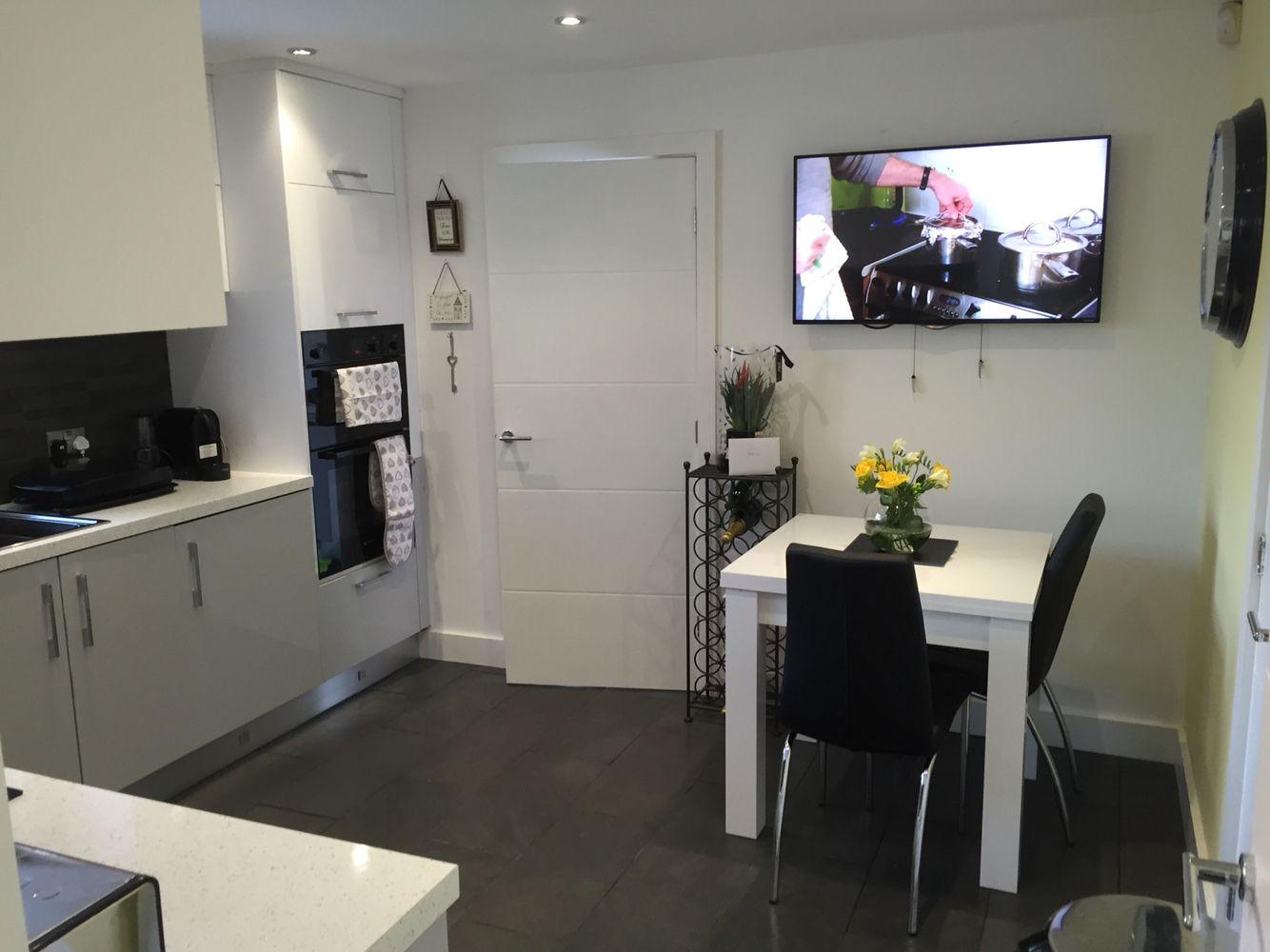 grey white n black kitchen with lemon  black kitchens