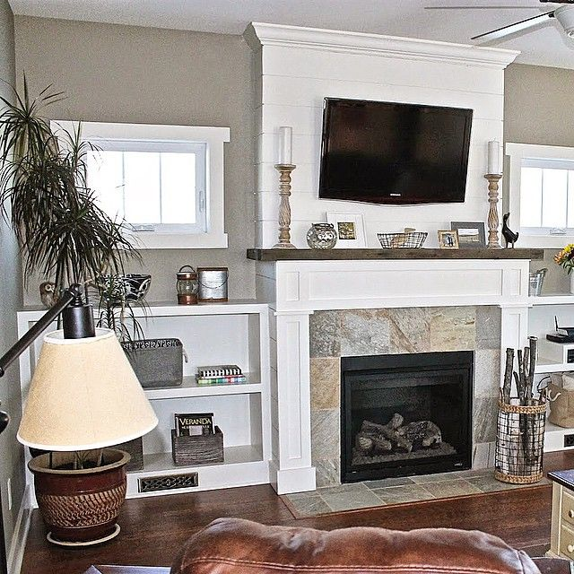 Built ins next to fireplace with venting for heat Open floor plan
