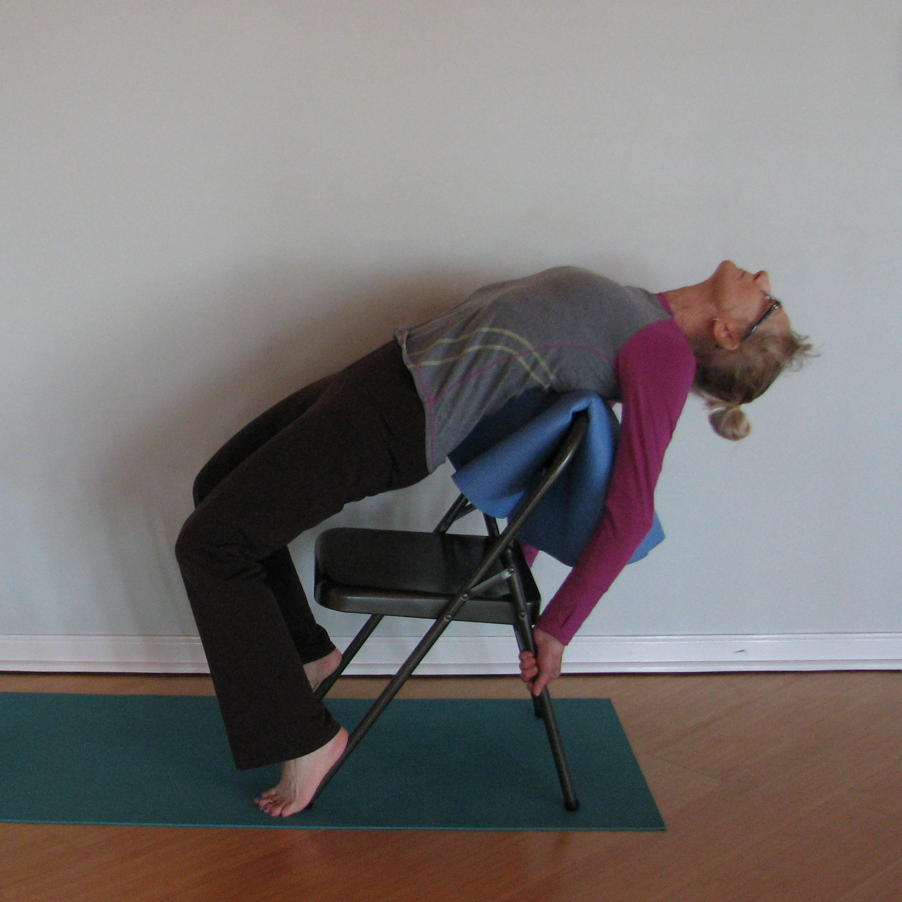 Back Bend Chair Wheel Feet On Chair Legs Hands Grip Chair Legs Arch Over Mat Bend Chair Chair Chair Legs