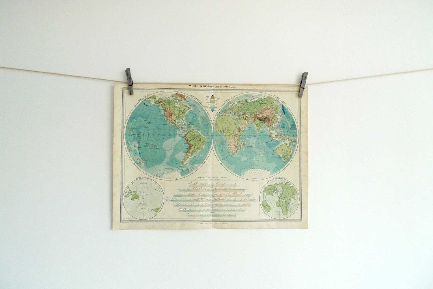 World Map Poster Print - a vintage map of the world in hemispheres. $25.00, via Etsy.