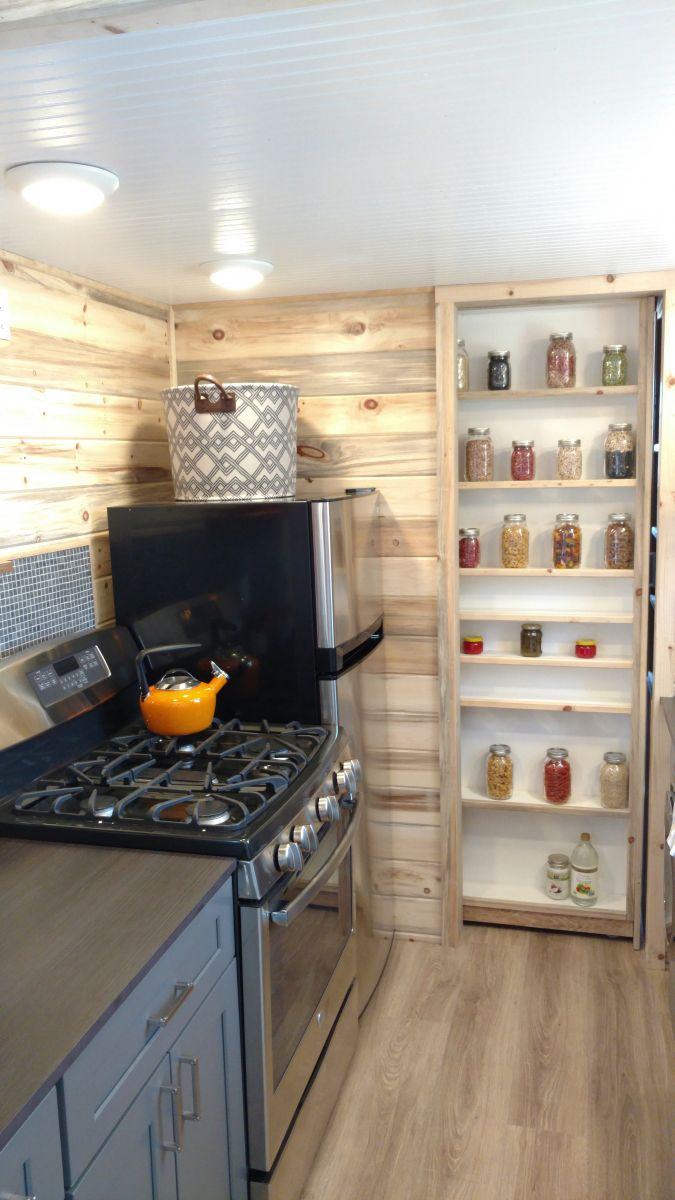 A small but functional galley kitchen includes