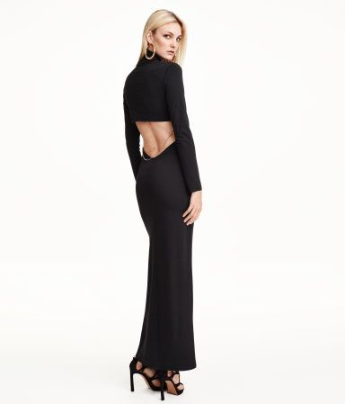 e3475932fe Fitted, open-back maxi dress in jersey. Turtleneck, cut-out section at back  with decorative, detachable metal chain, and long sleeves. High slit at  front.