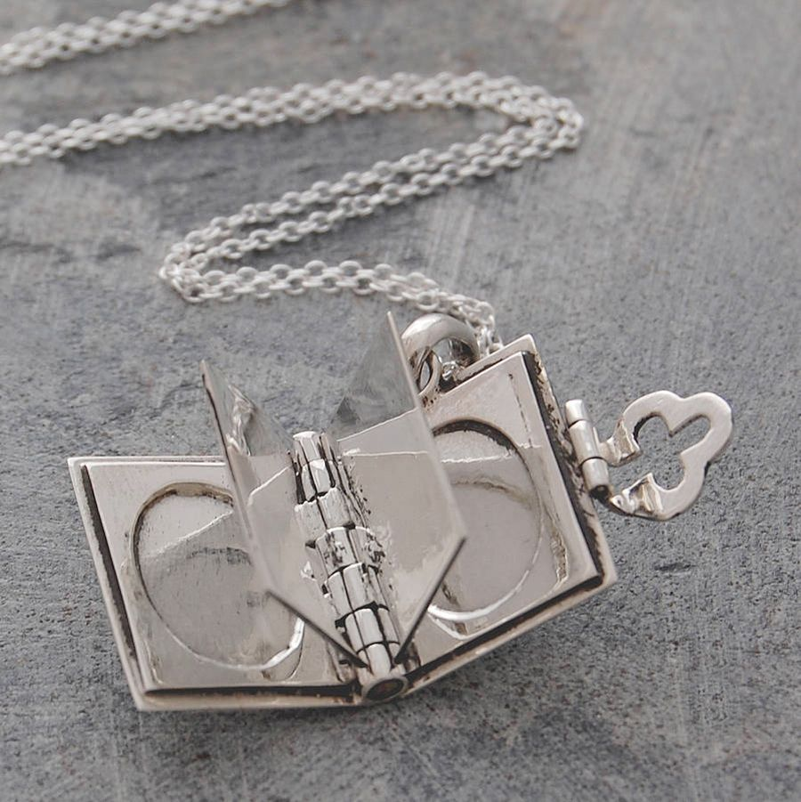 Silver book locket pendant opens to give you four pages for you to silver book locket pendant opens to give you four pages for you to personalise it with aloadofball Images